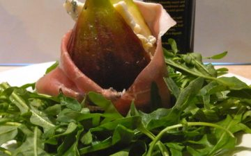 Fig wrapped in prosciutto filled with blue cheese and Vino Cotto